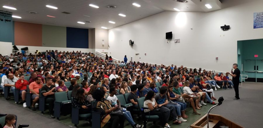 Principal+JC+DeArmas+addresses+the+crowd+at+the+New+Student+Orientation+on+August+17%2C+2019.+With+over+1000+attendees%2C+it+was+the+largest+orientation+in+South+Dade+history.